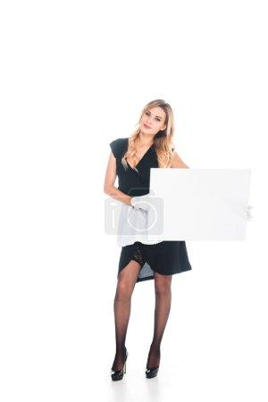 Foto de Mucama de uniforme negro con placa sobre fondo blanco - Imagen libre de derechos