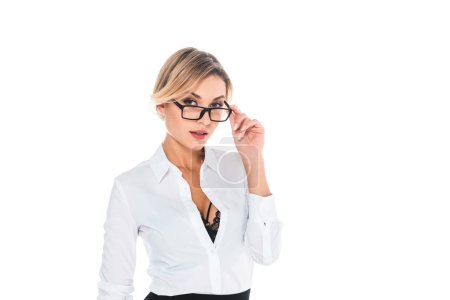 Photo for Attractive blonde teacher in blouse with open neckline taking off glasses isolated on white - Royalty Free Image
