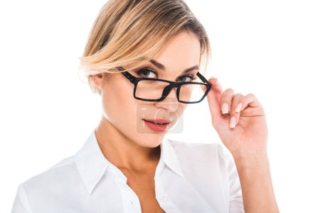 Photo for Attractive blonde teacher in blouse putting on glasses isolated on white - Royalty Free Image