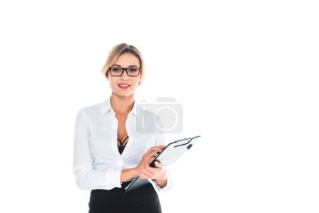Photo for Blond teacher in blouse with open neckline holding clipboard isolated on white - Royalty Free Image