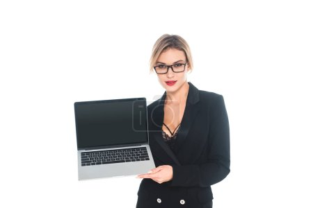 Photo for Attractive businesswoman in black formal wear holding laptop with blank screen isolated on white - Royalty Free Image