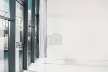 Photo for Windows in empty room with copy space, white background - Royalty Free Image