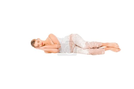 Photo for Girl in pyjamas sleeping in air isolated on white - Royalty Free Image