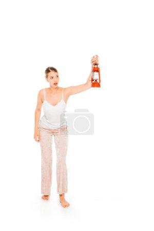 Photo for Floating girl in pyjamas holding lantern isolated on white - Royalty Free Image