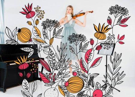 Photo pour Fille flottante en robe bleue jouant du violon avec illustration fleurs sauvages - image libre de droit
