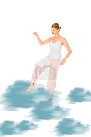 Photo pour Fille en pyjama lévitant avec illustration nuage bleu - image libre de droit