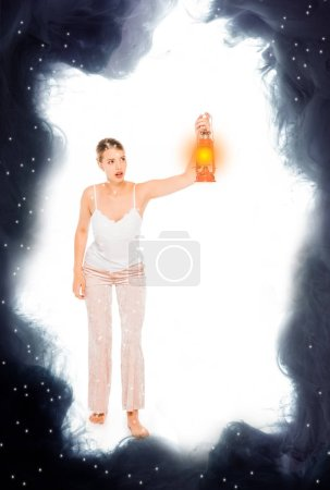 Photo for Girl in pyjamas holding lantern with black cloud illustration - Royalty Free Image