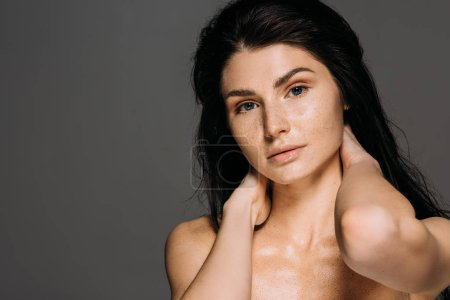 Photo for Attractive naked woman with freckles on face isolated on grey - Royalty Free Image