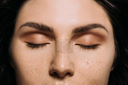 Photo for Close up view of girl with closed eyes and freckles on face - Royalty Free Image