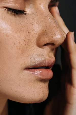 Photo for Close up view of tender woman with freckles on face isolated on grey - Royalty Free Image