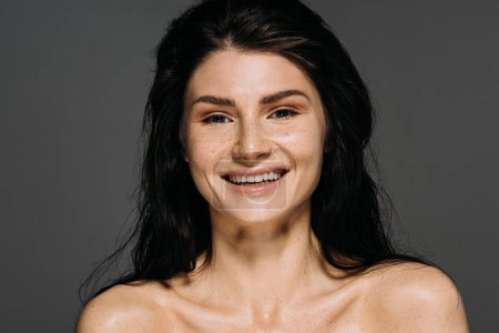 Photo for Portrait of happy emotional girl with freckles on face isolated on grey - Royalty Free Image