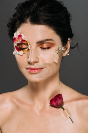 Photo for Beautiful dreamy woman with closed eyes and flowers on body isolated on grey - Royalty Free Image