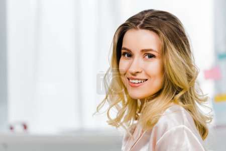 Photo for Excited blonde young woman looking at camera with sincere smile - Royalty Free Image