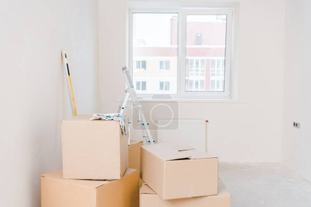 Photo for Room with carton boxes and metallic ladder - Royalty Free Image