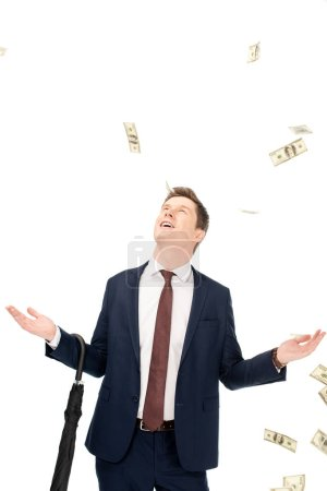 Photo for Successful businessman with falling dollar banknotes isolated on white - Royalty Free Image