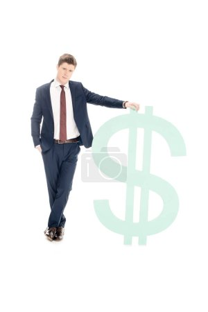 Photo for Successful businessman posing with big dollar symbol isolated on white - Royalty Free Image