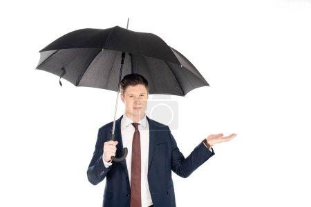 Photo pour Bel homme d'affaires avec parapluie vérifiant la pluie, isolé sur blanc - image libre de droit