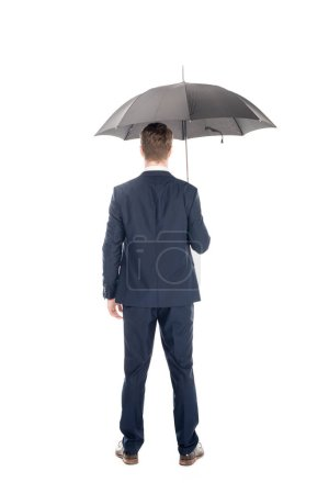 rear view of businessman standing with umbrella isolated on white