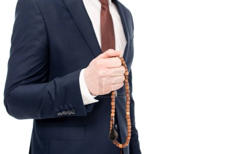 Photo for Cropped view of businessman praying and holding rosary beads isolated on white - Royalty Free Image