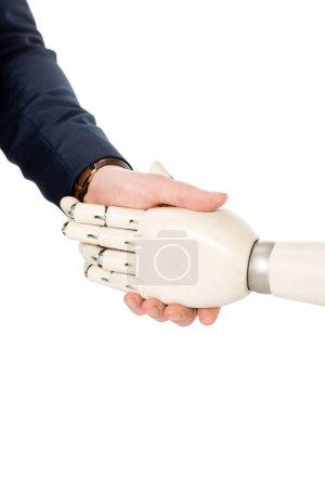 Photo pour Vue recadrée d'homme d'affaires, se serrant la main avec le bras robotisé isolé sur blanc - image libre de droit