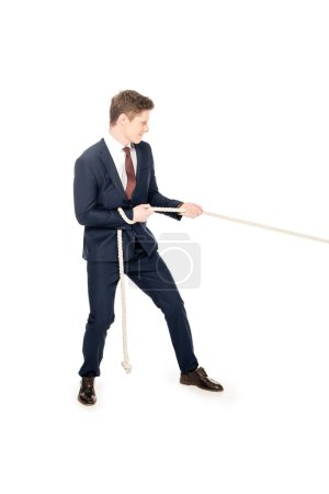 Photo for Young stylish businessman pulling rope isolated on white - Royalty Free Image