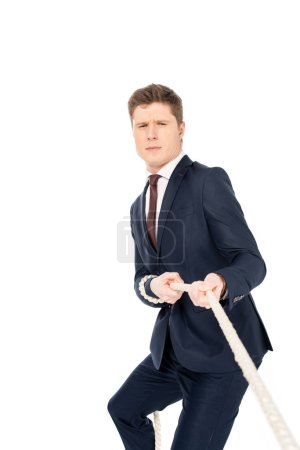 Photo for Young male leader pulling rope isolated on white - Royalty Free Image