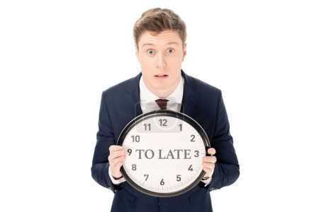 """Photo for Shocked businessman holding clock with """"to late"""" lettering isolated on white - Royalty Free Image"""