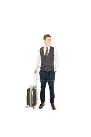 handsome stylish businessman with baggage for business trip, isolated on white
