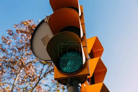 traffic light with clear blue sky on background, barcelona, spain