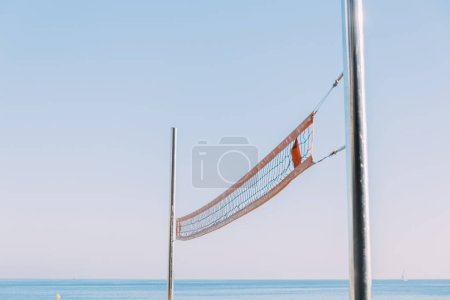 beach volleyball net on blue sky background, barcelona, spain