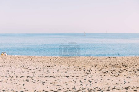 BARCELONA, SPAIN - DECEMBER 28, 2018: scenic view of calm sea and sand beach