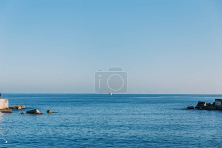 BARCELONA, SPAIN - DECEMBER 28, 2018: scenic view of tranquil blue sea and skyline