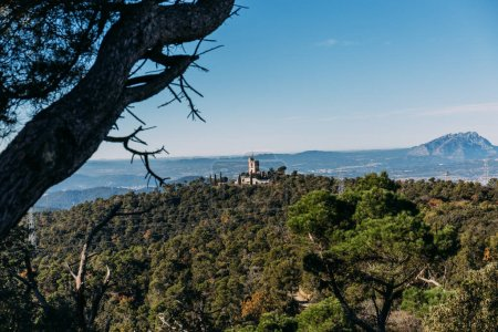 Photo for Landscape with green forest and castle on hills, barcelona, spain - Royalty Free Image