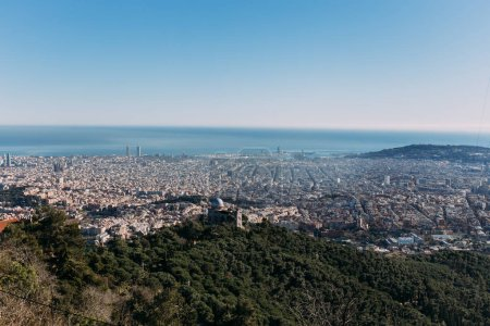 Photo for Aerial view of city at foot of green hills, barcelona, spain - Royalty Free Image