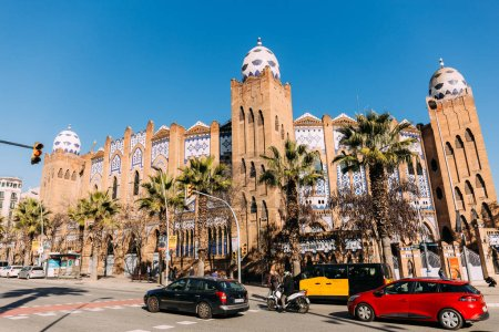 BARCELONA, SPAIN - DECEMBER 28, 2018: busy street with cars and beautiful old building