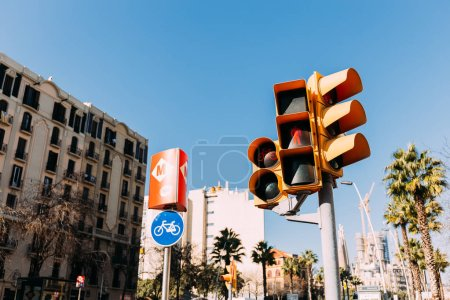 urban scene with buildings, traffic light and road sign, barcelona, spain