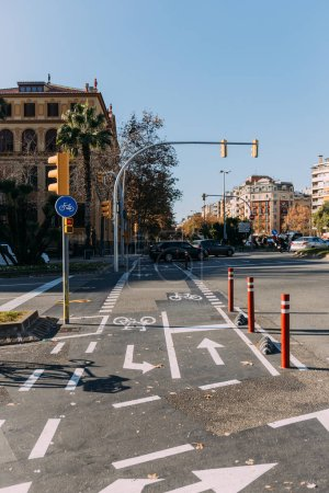 Photo for BARCELONA, SPAIN - DECEMBER 28, 2018: road with bicycle path, markings and traffic lights - Royalty Free Image