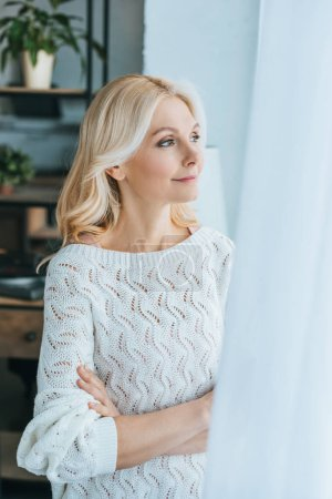 Photo for Cheerful woman standing with crossed arms at home - Royalty Free Image