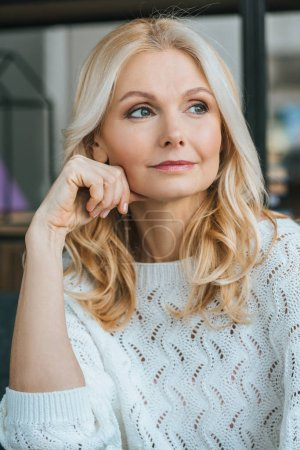 Photo for Dreamy woman with blonde hair thinking at home - Royalty Free Image