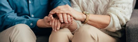 Photo for Cropped view of couple holding hands at home - Royalty Free Image