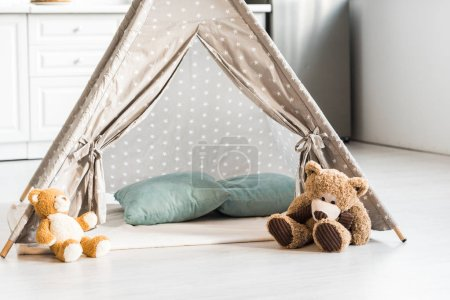 Photo for Modern interior design of nursery room with baby wigwam and teddy bears - Royalty Free Image