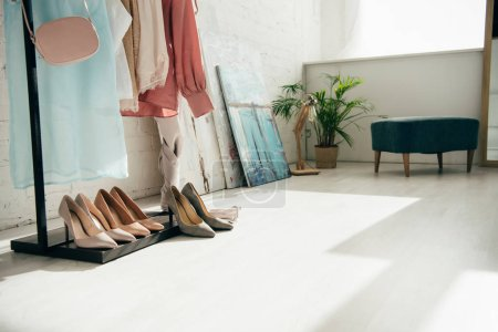 Photo for Fashionable clothes near high heels and white brick wall - Royalty Free Image