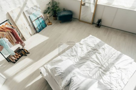 Photo for Overhead view of modern white bedroom with bed and stylish wardrobe - Royalty Free Image