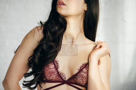 Photo for Cropped view of sexy brunette young woman in lace bra - Royalty Free Image