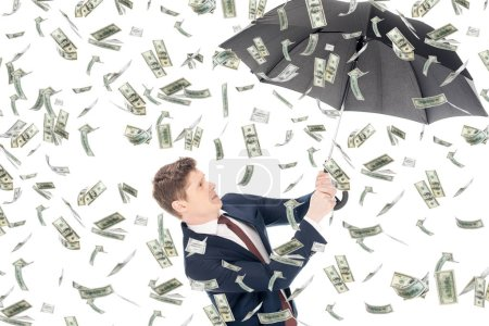 successful businessman in suit holding