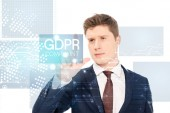 successful businessman in suit pointing with finger at gdpr compliant illustration on white background