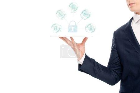 Photo pour Recadrée vue d'homme d'affaires détenant une tablette numérique avec des icônes de sécurité internet ci-dessus - image libre de droit