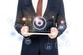 """Постер, картина, фотообои """"обрезанное мнению бизнесмена, держа цифрового планшета в руках с Интернет безопасности икон выше"""""""