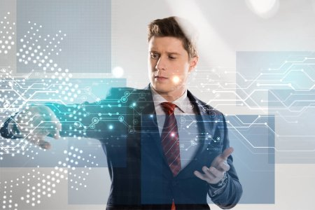 Photo for Confident businessman in suit pointing with hands at network illustration in front - Royalty Free Image