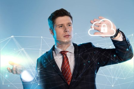 handsome businessman in suit pointing at network and lock in cloud illustration in front on blue background